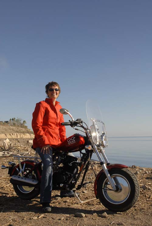 Arleneon her Go Go Gear CSC motorcycle...that's the Sea of Cortez in the background