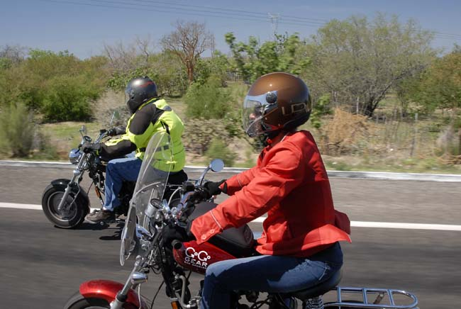 Arlene and John riding in very hot weather wearing full protective gear