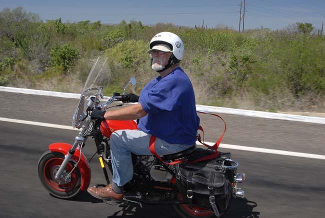 Simon on my bike...you gotta love those red suspenders!