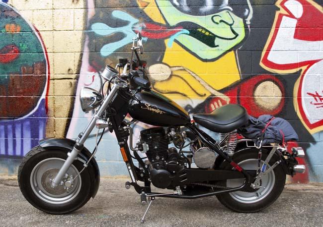 TK's Classic California Scooter against a graffiti background