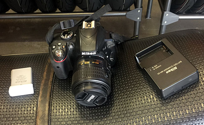 A spare battery, the D3300 NIkon with its 18-55 lens, and the battery charger (all of which fit into the Tamrac case).  This is a great DSLR camera with more capability than most folks will ever need.