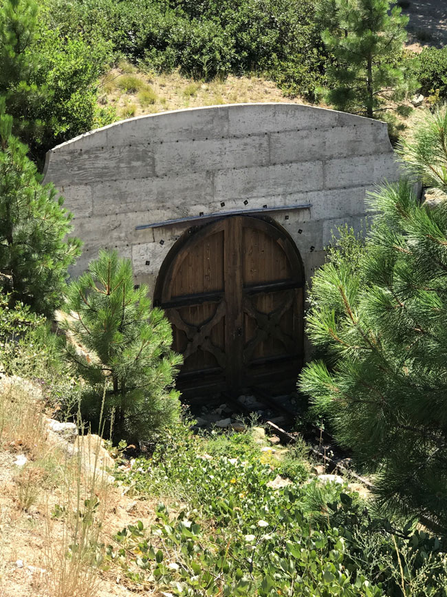100ft tunnel with ornate wood doors on both ends
