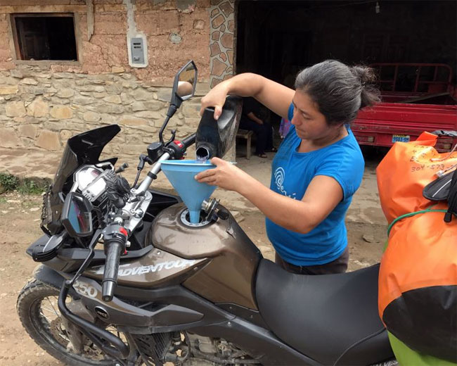 OleGeezer's bike taking on fuel somewhere in South America